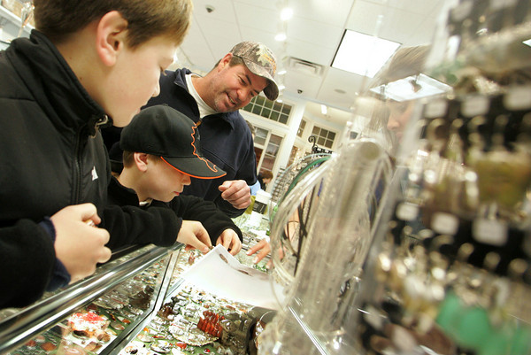 Gloucester: Keith MacIntyre and his sons, Jacob, 11, left, and Ryan, 9, shop for a special gift for mom at the Village Silversmith during Men's Night on Main Street Thursday night. Mary Muckenhoupt/Gloucester Daily Times