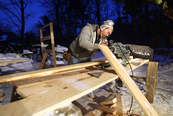 Manchester: Mike Naves cuts planks of pine to make the stable for the Manchester Community Wide Christmas Eve celebration, which involves a live nativity. Naves and Mark Powers, Charles O'Neil, and Ted Bries all volunteered their time to build the stable, while the Building Center, Markham Lumber, and Plante Construction donated materials. Photo by Kate Glass/Gloucester Daily Times