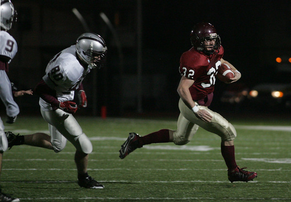 Lynn: Gloucester's Conor Ressel gets past Westford Academy's Michael Miceli as he runs for a touchdown at Manning Field in Lynn last night. Photo by Kate Glass/Gloucester Daily Times