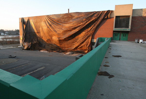 Gloucester: The roof over the O'Maley Middle School Auditorium blew off yesterday afternoon, taking a skylight with it. Debris was scattered across the walkway and parking lot. Photo by Kate Glass/Gloucester Daily Times