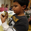 Essex: Jack Ashley paints his name on an ornament at Essex Elementary School after school on Wednesday. The kids created snow globes and ornaments to give as gifts over the holidays. Photo by Kate Glass/Gloucester Daily Times