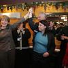Gloucester: State Rep. Ann-Margaret Ferrante holds hands with Martha Coakley while endorsing Coakley for the U.S. Senate seat at La Trattoria Restaurant on Main Street Friday. Also pictured is City Counselors Sefatia Romeo Theken, Joe Ciolino, Police Chief Mike Lane and Ann Sheinwald. Mary Muckenhoupt/Gloucester Daily Times <br /> <br /> .