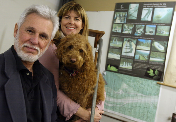 Essex: Ron Magers and Shelly Bradbury, shown here with their dog, Lulu, created the design for the Old Man in the Mountain memorial, which was supposed to have been completed in 2010, but only $650,000 of the $5 million needed for the project has been raised. Photo by Kate Glass/Gloucester Daily Times