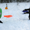 Rockport: Nicky Endicott, right, tosses a sled full of snow at David Todd, left, but David was ready with his shield as they played at Evans Field. Photo by Kate Glass/Gloucester Daily Times