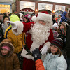 Rockport:  Santa pushes through the crowds of children who came to see him at the Rockport tree lighting in Dock Square Saturday afternoon. Mary Muckenhoupt/Gloucester Daily Times