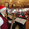 Gloucester: Christian Taylor plays the saxaphone as the Docksiders hold their benefit breakfast at City Hall Saturday morning.  The breakfast included Disney characters for kids and was held to help raise money for the Docksider's upcoming trip to Hawaii. Mary Muckenhoupt/Gloucester Daily Times