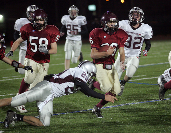 Lynn: Gloucester's Brandon Cusumano runs past Westford Academy's defense as teammate Jeff Lane tries to clear him a path during their 34-28 win over Westford Academy at Manning Field in Lynn last night. Photo by Kate Glass/Gloucester Daily Times