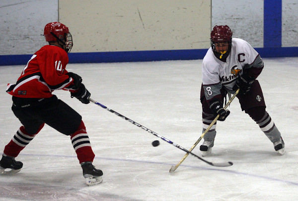 Gloucester: Rockport's Pat Hoffman and Amesbury's Garrett King battle for the puck at the Talbot Rink. Photo by Kate Glass/Gloucester Daily Times