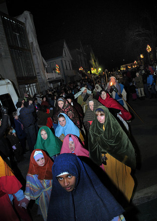 Rockport: Performers walk down Main St to the the 1st Congreational Church were they reenact the birth of Christ, for the 64th Annual Christmas Nativity Pageant held Saturday night. Desi Smith Photo/Gloucester Daily Times. December 19,2009.