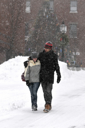 Gloucester: Sarah Peck and Randy Jones walk along Main St during the first snowfall of the year, sunday afternoon.  Desi Smith Photo/Gloucester Daily Times. December 20,2009.