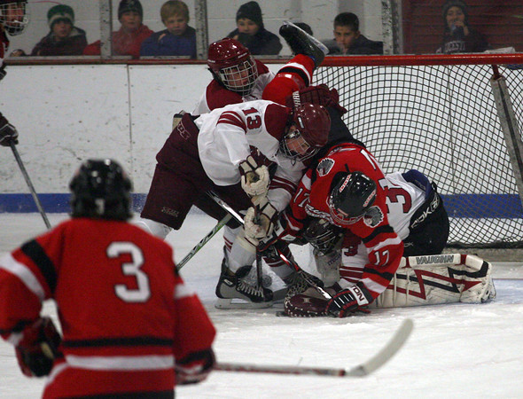 Gloucester: Saugus' Rob Snow gets upended by Gloucester's Alex Webb and Dominic Novello at the Talbot Rink last night. Photo by Kate Glass/Gloucester Daily Times Wednesday, December 16, 2009