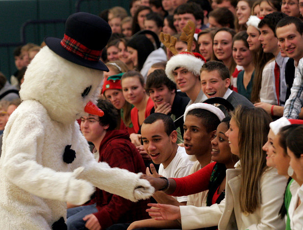 Manchester: Frosty the Snowman greets Ariella Bennett during the Manchester Essex Regional High and Middle School Holiday Assembly on Wednesday. Students and faculty performed holiday songs on their last day of school before break. Photo by Kate Glass/Gloucester Daily Times