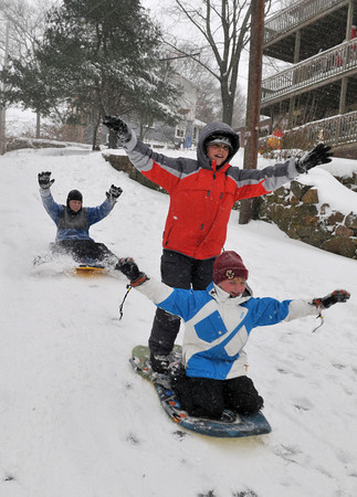 Gloucester: Front to back Quinn Murdock 9, Jordan Govoni 11, and Mathiew Pastagal 12, enjoy the first snowfall of the year, sunday afternoon on Clearveiw Ave. Desi Smith Photo/Gloucester Daily Times. December 20,2009.