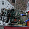 Rockport: Gus Contrino unloads lobster traps from his boat, Gussy's Girls, at T-Wharf on Wednesday. Photo by Kate Glass/Gloucester Daily Times Wednesday, December 2, 2009