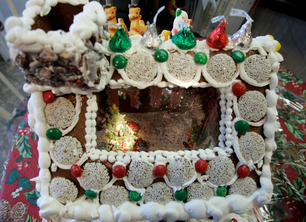 Gloucester: Barbara Catalini of Cakes by Barbara decorated this gingerbread house with a skylight window to view the decorated tree and hearth inside. Photo by Kate Glass/Gloucester Daily Times Wednesday, December 8, 2009