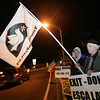 Gloucester: John Schuchardt, front, and John Mullen holds signs for peace as people protest President Obama's decision to send more troops to Afghanistan at Grant Circle Wednesday evening. Mary Muckenhoupt/Gloucester Daily Times