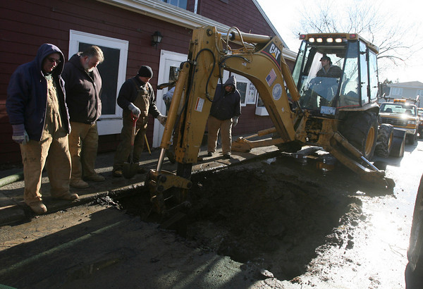 Gloucester: Gloucester DPW workers repair a broken water main in front of The Studio on Rocky Neck yesterday afternoon. The crew has been busy lately, as another main broke on Main Street Tuesday. Photo by Kate Glass/Gloucester Daily Times