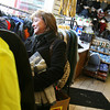 Gloucester: Claire MacDonald of Gloucester browses the racks at Nelson's while looking for last-minute Christmas presents yesterday afternoon. MacDonald says she had planned to wrap presents on Sunday so she wasn't thrown off by the snow, but says the snow wouldn't stop her from shopping, especially downtown. Photo by Kate Glass/Gloucester Daily Times