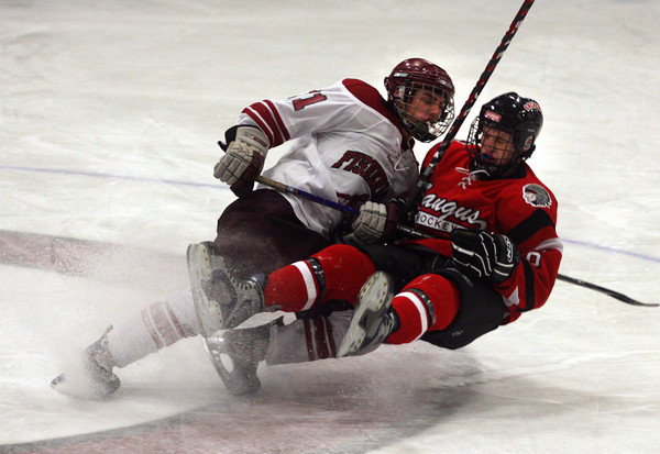Gloucester: Gloucester's Ben Chianciola and Saugus' Mike Green collide during the Fishermen's home opener last night. Photo by Kate Glass/Gloucester Daily Times Wednesday, December 16, 2009