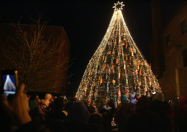 Gloucester: Hundreds turned out to watch the lighting of the Lobster Trap Tree in front of the police station on Main Street Saturday evening.  Mary Muckenhoupt/Gloucester Daily Times