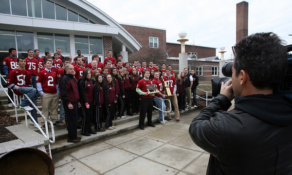 """Gloucester: Channel 5 photographer Mike Cole shoots footage of the Gloucester High super bowl champion football team and state champion cheerleading squad to be featured in sports anchor Mike Lynch's """"High Five"""" report. The segment will air Thursday during the 6 o'clock news and Sunday during the 11 o'clock news. Photo by Kate Glass/Gloucester Daily Times Tuesday, December 15, 2009"""
