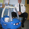 Essex Police Chief Peter Silva sits next to the Essex Police DepartmentÕs new Little Tikes toy police cruiser which mysteriously showed up in his parking spot last Saturday.  Jonathan Phelps/Gloucester Daily Times