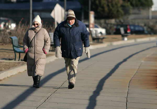 """Rockport: Enid and David Wise of Rockport brave the cold and walk Stacy Boulevard Thursday afternoon.  """"It's not so bad once you get moving,"""" said Enid. """"It's the power of inertia."""" Mary Muckenhoupt/Gloucester Daily Times"""