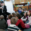 "Manchester: Dr. Jack Mara, Manchester Memorial School Principal, reads ""The Polar Express"" to students in Mrs. Heslop's first grade class during their last day of school before winter break. Photo by Kate Glass/Gloucester Daily Times"