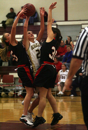 Gloucester: Gloucester's Heather Cain is guarded by Marblehead's Bridgett Forbes and Lyndsay Cohen at the Benjamin A. Smith Field House last night. Photo by Kate Glass/Gloucester Daily Times