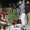 Lynn: Gloucester's Jeff Lane looks up at the official as he rules a fumble was recovered by Westford Academy during their game at Manning Field in Lynn last night. Photo by Kate Glass/Gloucester Daily Times
