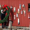 Rockport: Rockport DPW employee Dan Rapp carries the wreath that he and his co-workers, Steve Ranta and Chuck Osmond, will hang on Motif #1 as they finish decorating for the holidays on Wednesday. Photo by Kate Glass/Gloucester Daily Times Wednesday, December 2, 2009