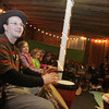 Rockport: Arlen Holland participates in the drum jam lead by Jon Holland and Dragon Company at the Masonic Hall on Broad Street for New Year's Rockport Eve Thursday evening.  Mary Mucenhoupt/Gloucester Daily Times