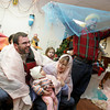 Gloucester: Marco Ray, his wife Julie, daughter Vivian, 9 months, and father Martin put on an impromptu nativity scene at the end of the Family Folktale and Pupet Show put on by Dora Tevan at the Fish Shack Restaurant for New Year's Rockport Eve Thursday night. Mary Muckenhoupt/Gloucester Daily Times