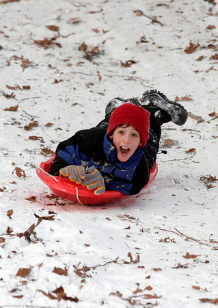 Rockport: Alex Strzemilowski, 8, screams as the sleds head first down the hill at Evans Field. The snow quickly disappeared as kids flocked to the popular sledding spot for the season's first snowfall. Photo by Kate Glass/Gloucester Daily Times