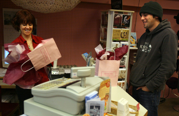 Gloucester: Nancy Hendrickson, owner of Seasons on Main, wraps gifts for Tim Greely of Rockport as he does some last-minute shopping for his sister-in-laws yesterday afternoon. Photo by Kate Glass/Gloucester Daily Times
