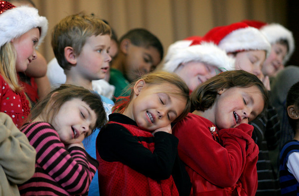"""Gloucester: Beeman Elementary School kindergarteners pretend to be sleeping while singing """"Santa Claus is Coming to Town"""" during the school's holiday concert yesterday afternoon. Photo by Kate Glass/Gloucester Daily Times Wednesday, December 16, 2009"""