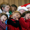 "Gloucester: Beeman Elementary School kindergarteners pretend to be sleeping while singing ""Santa Claus is Coming to Town"" during the school's holiday concert yesterday afternoon. Photo by Kate Glass/Gloucester Daily Times Wednesday, December 16, 2009"