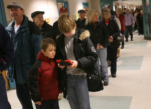Rockport: A long line of Cape Ann residents wait to receive the H1N1 flu vaccine at Rockport Elementary School last night during the first of three free clinics. The next clinic will be held tonight at Legion Hall in Manchester from 4 to 7 and the third clinic will be at Fuller School from 4 to 7 on January 7th. For more information, call the Gloucester Health Department 978-281-9771. Photo by Kate Glass/Gloucester Daily Times