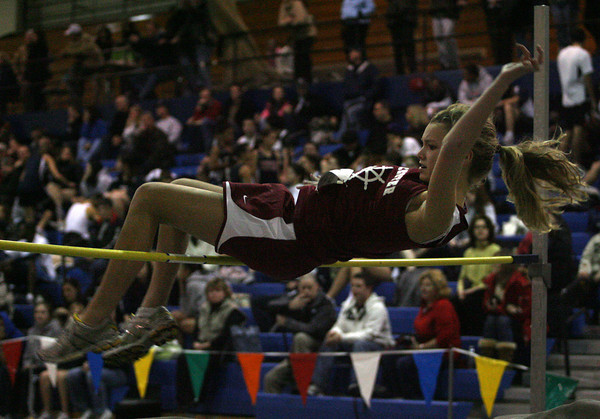 Peabody: Gloucester's Hannah Sumner clears the bar as she competes in the high jump during their meet against Revere at Peabody High School last night. Photo by Kate Glass/Gloucester Daily Times