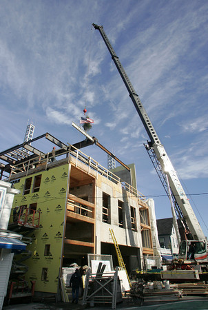 Rockport: The ceremonial attached to a beam was placed atop the Shalin Liu Performance Center in Rockport Friday morning. Mary Muckenhoupt/Gloucester Daily Times