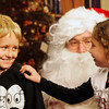 Gloucester: Lauren Alves puts her hand on her big brother Caleb as she admits to Santa that Caleb was in fact a good big brother this year at the Cape Ann TV Studio Friday afternoon. Children of Cape Ann were invited to meet Santa at the studio so their meeting would be taped and air on Christmas Eve and Christmas Day. Mary Muckenhoupt/Gloucester Daily Times