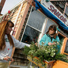 Gloucester: Kim MacIsaac helps Karen Roberts, owner of Sailor Stan's decorate window boxes as Rocky Neck gets ready for the seond annual Winter Stroll Wednesday afternoon.  The stroll is offerend the weekends of Dec. 5-6, 12-13, and 19-20. Mary Muckenhoupt/Gloucester Daily Times