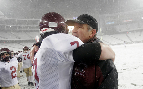 Foxborough: Gloucester quarterback Brett Cahill hugs head coach Paul Ingram following their 33-13 victory over Bridgdewater-Raynham in the Division IA Superbowl at Gillette Stadium on Saturday night. Photo by Kate Glass/Gloucester Daily Times
