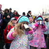 Gloucester:  Maddox Slyman, 3, of Rockport sips hot chocolate with her sister Lexi, 5, as the girls wait for the tree to be lit at Dock Square Saturday evening. Mary Muckenhoupt/Gloucester Daily Times