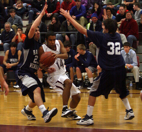 Gloucester: Rockport's Andres Contreras ducks between Hamilton-Wenham's Isaac Carp and Jake Prince during the championship game of the 4th Annual BankGloucester Holiday Tournament last night. Photo by Kate Glass/Gloucester Daily Times