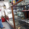 Gloucester: Mary Ellen Kullgren and her daughter, Juno, 6 months, look at the jewelry at Bananas yesterday afternoon. Photo by Kate Glass/Gloucester Daily Times
