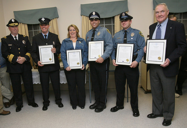 Essex: Essex Police Chief Peter Silva, left, recognized five people for their efforts in saving the lives of Hyman and Helen Novak when their car plunged into the Essex River in October during a ceremony at the Essex Senior Center on Monday night. Those honored are: Peabody Firefighter and Essex resident Steve Pellegrini, Dispatcher Theresa Mansfield, Essex Patrolmen David Earle and James Romeos, and Assistant Harbormaster Jason Simpson. Photo by Kate Glass/Gloucester Daily Times