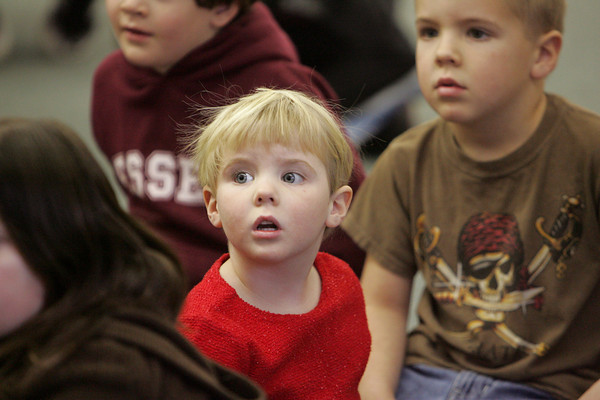 """Essex: Libby Mulry, 4, listens intently to """"The Nutcracker"""" read by librarian April Wanner during the Nutcracker celebration held at the TOHP Burnham Library Saturday afternoon. Mary Muckenhoupt/Gloucester Daily Times"""