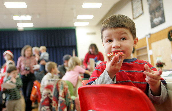 Essex: Dexter Woodman, 3, enjoys the cookie that he just made at the Breakfast with Santa at Essex Elementary School Saturday morning. Mary Muckenhoupt/Gloucester Daily Times