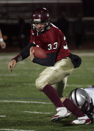 Lynn: Gloucester's Jordan Shairs runs the ball against Westford Academy at Manning Field in Lynn last night. Photo by Kate Glass/Gloucester Daily Times